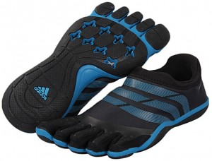... for optimal training in these men's Adipure Trainer shoes by adidas. The toes are liberated so your foot can move as freely as if you were barefoot, ...
